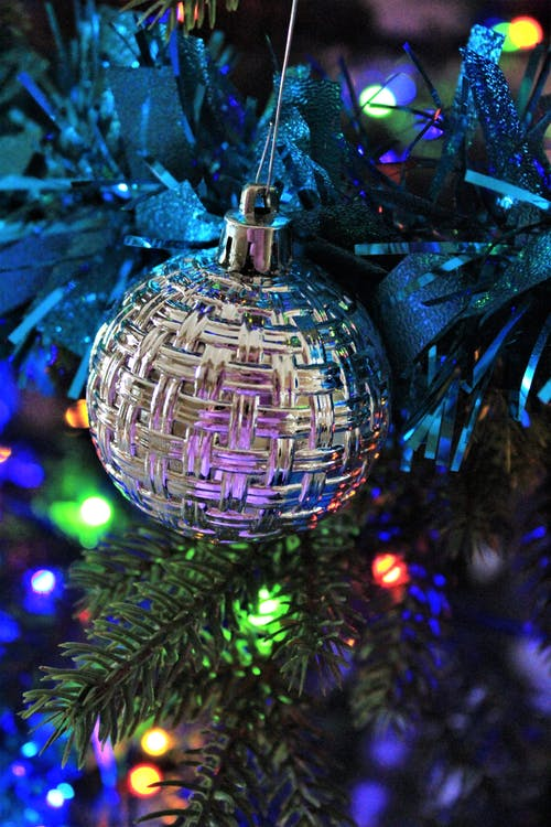 Silver Bauble on Green Christmas Tree