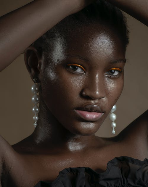 Gorgeous black woman with pearl earrings