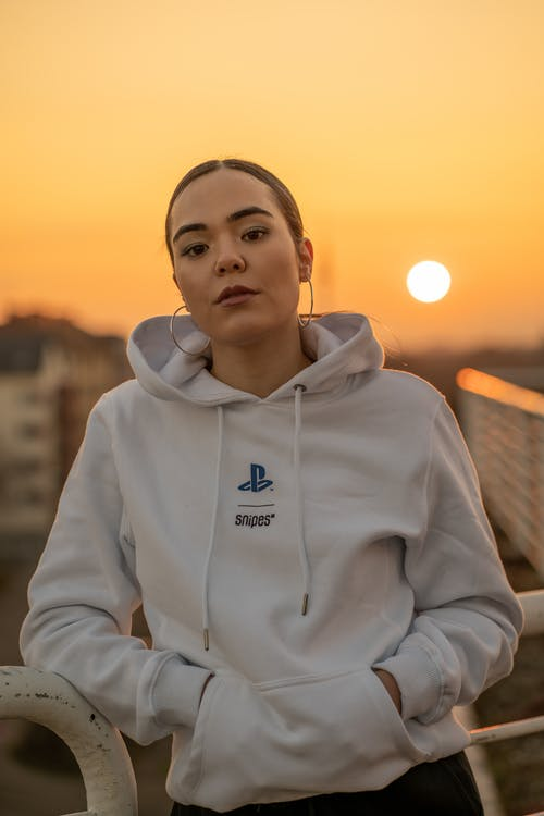 Woman in White Adidas Pullover Hoodie