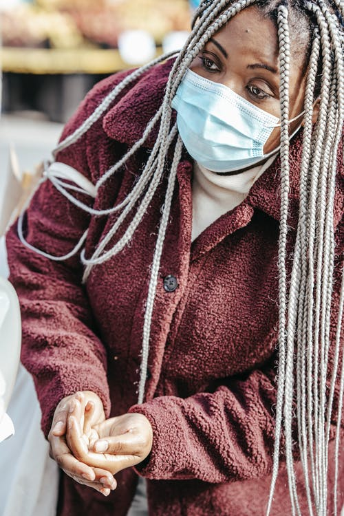 Black woman in protective mask on street
