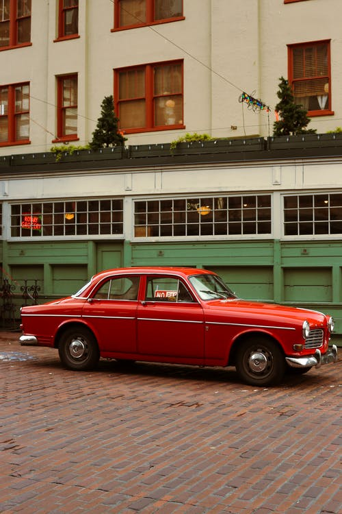 Retro car on tiled pavement in town