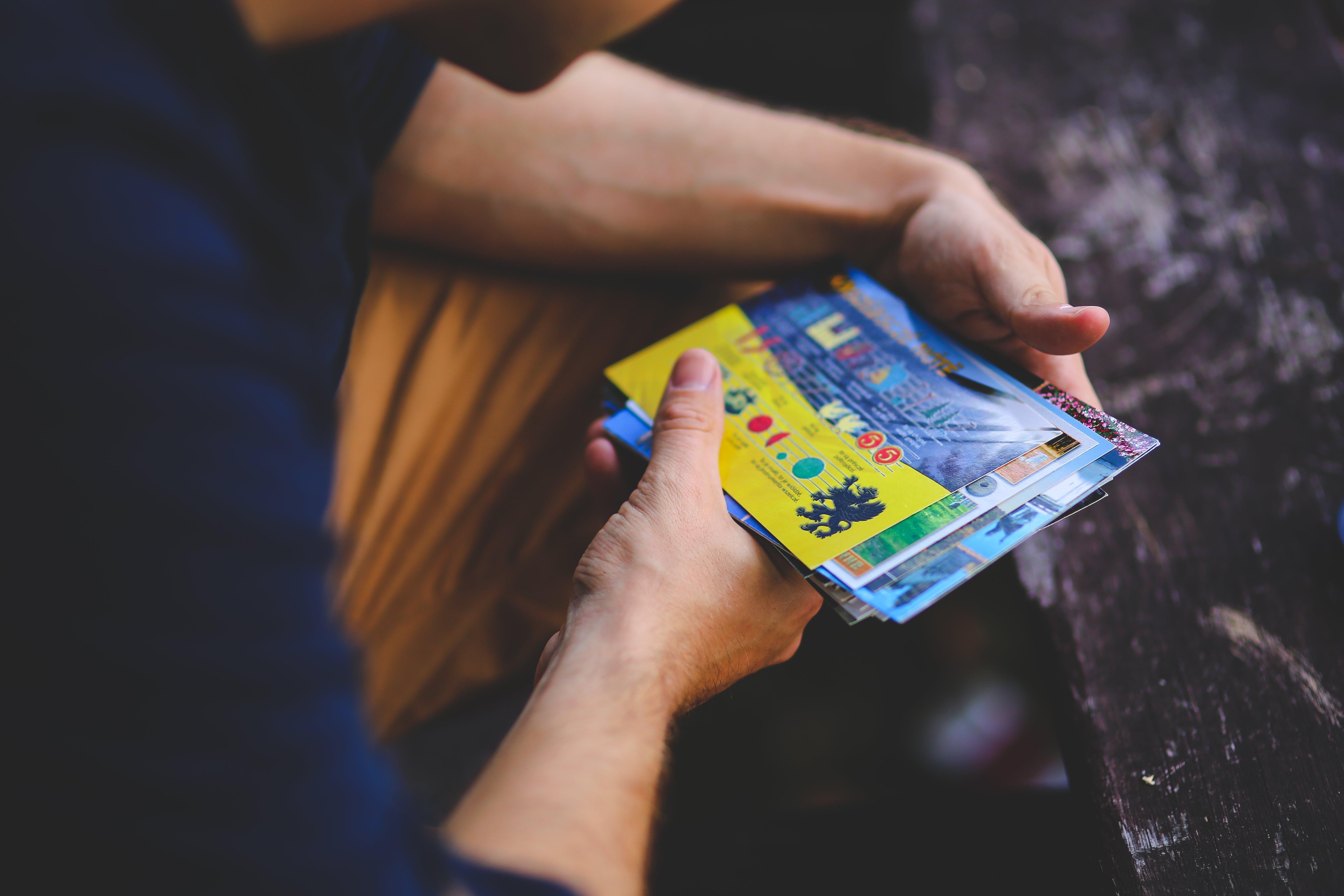 Man looking at postcards