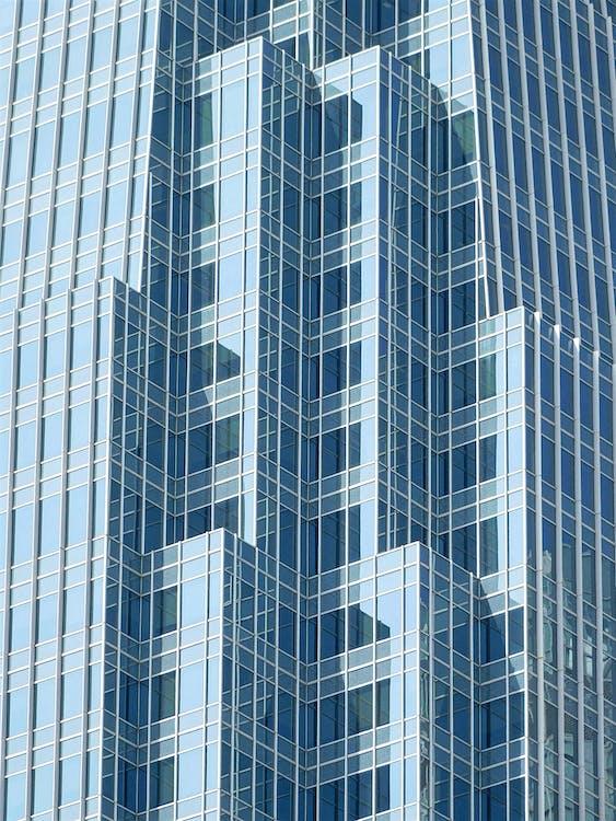 Facade of modern glass skyscraper in daytime