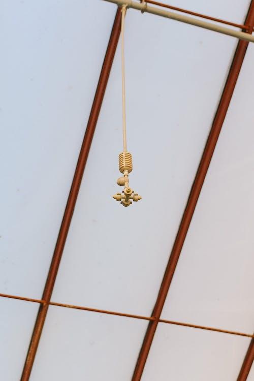 Hanging Brown Water Sprinkler