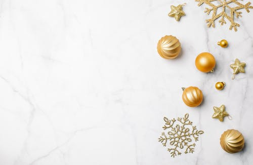 Christmas decorations placed on marble surface