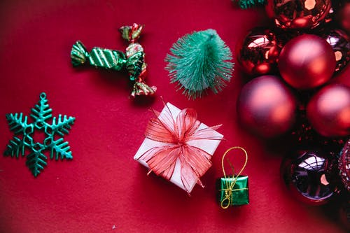 Colorful Christmas decor with gift boxes and baubles