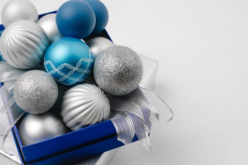 Festive sparkling silver and blue baubles in box