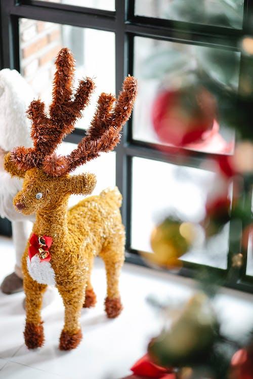 Toy reindeer placed on windowsill