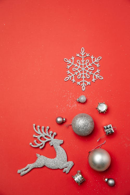 Christmas composition with decorative reindeer and snowflake