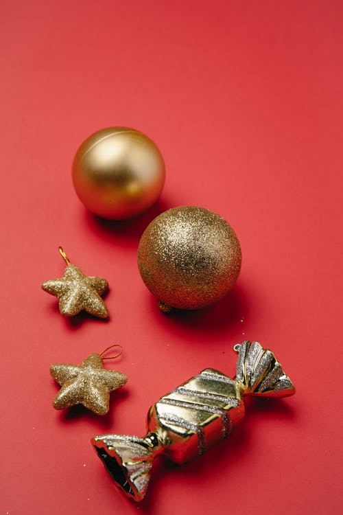 Christmas composition of shiny golden decorations and sweet