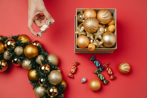 Person taking bonbon from Christmas composition