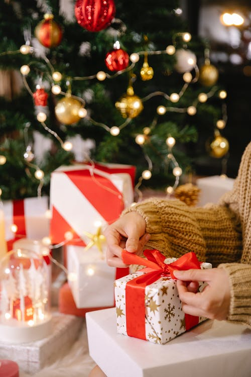 Woman packaging Christmas present in box