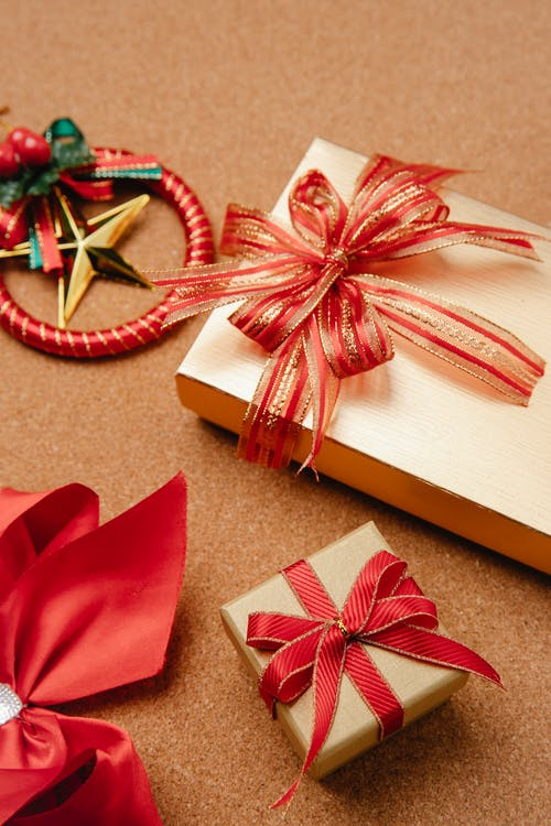Big and small boxes with Christmas presents on table