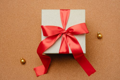Gift box with ribbon on table