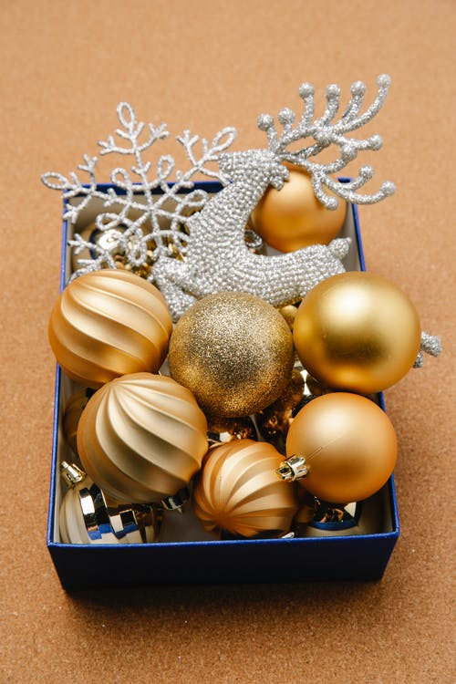 Box with shiny baubles and festive ornaments