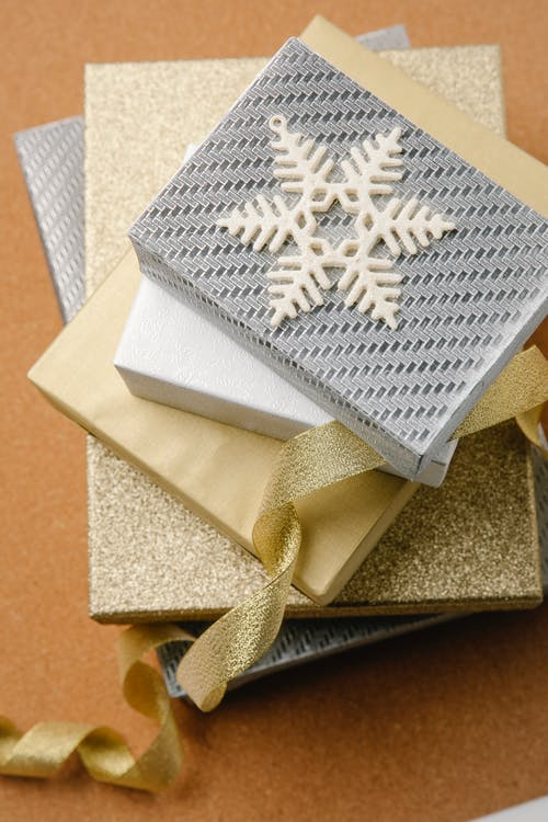 Christmas gift boxes wrapped in silver and golden paper
