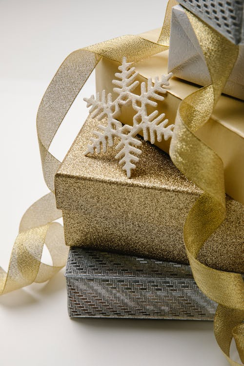 Gold Gift Box With White Ribbon
