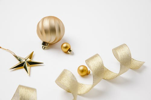 Christmas composition of golden ribbon and hanging decorations