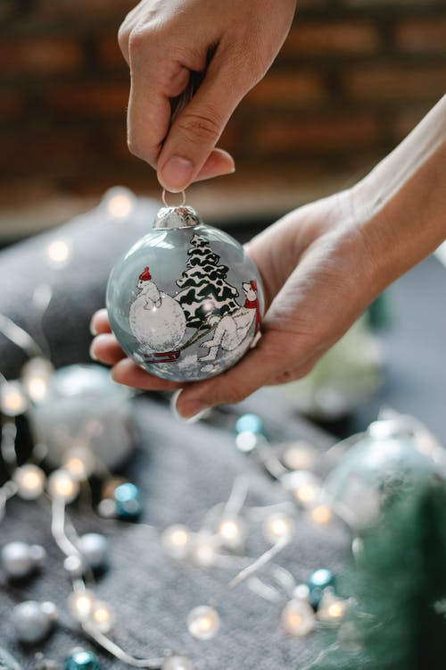 Decorative bauble with painted Christmas picture