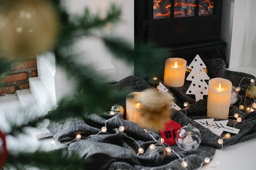 Christmas decorations near fireplace at home