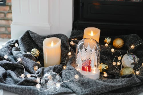 Christmas decoration placed on blanket on floor