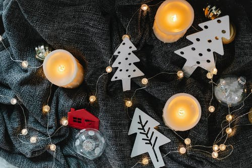 Christmas decorations placed on gray fabric surface
