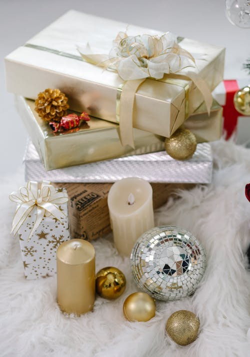 Christmas decorations and gifts on table