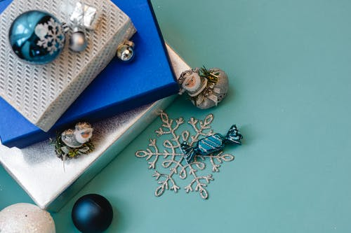 Festive decorations and presents on blue background