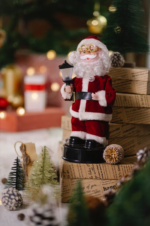 Christmas decorations and toys near gift boxes