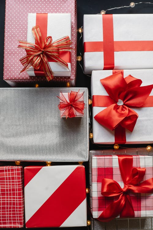 Gift boxes with red ribbons for Christmas celebration