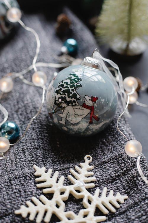 Christmas garland on bauble near star