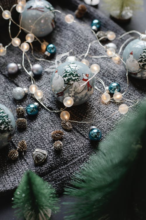Shiny baubles with garland and fir cones