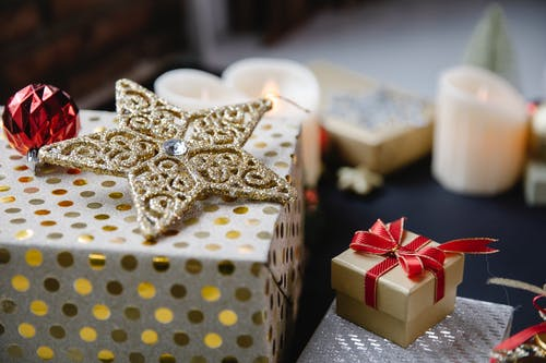 Decorative objects for Christmas on black surface