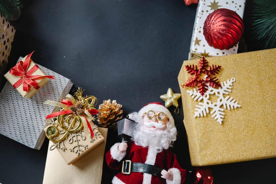 Colorful gift boxes and Santa Claus toy