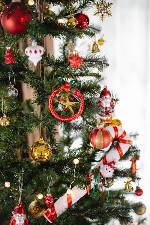 Gold and Red Baubles on Green Christmas Tree