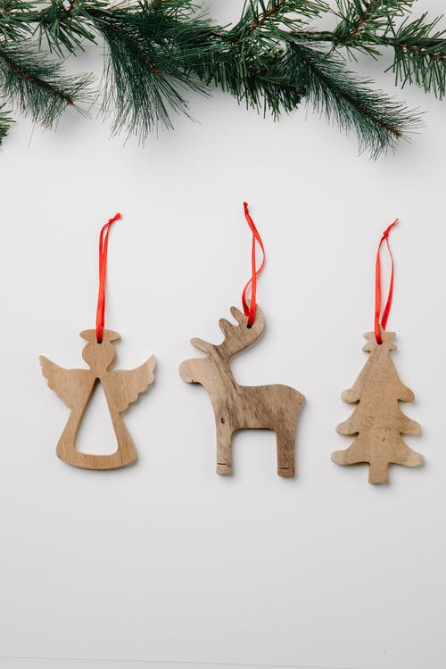 Wooden decor and fir tree branch on Christmas day