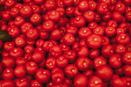 Red Round Fruits on Brown Wooden Table