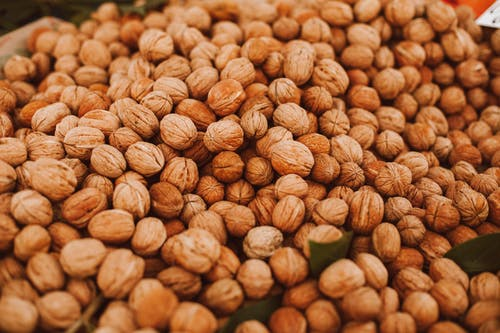 Brown Almond Nuts on Green Leaves