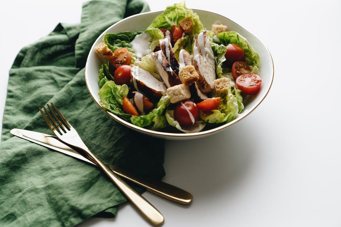 Vegetable Salad in White Ceramic Bowl Beside Stainless Steel Fork