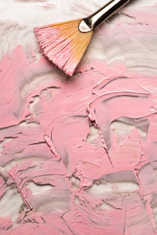 Brown Wooden Brush on Pink Rock