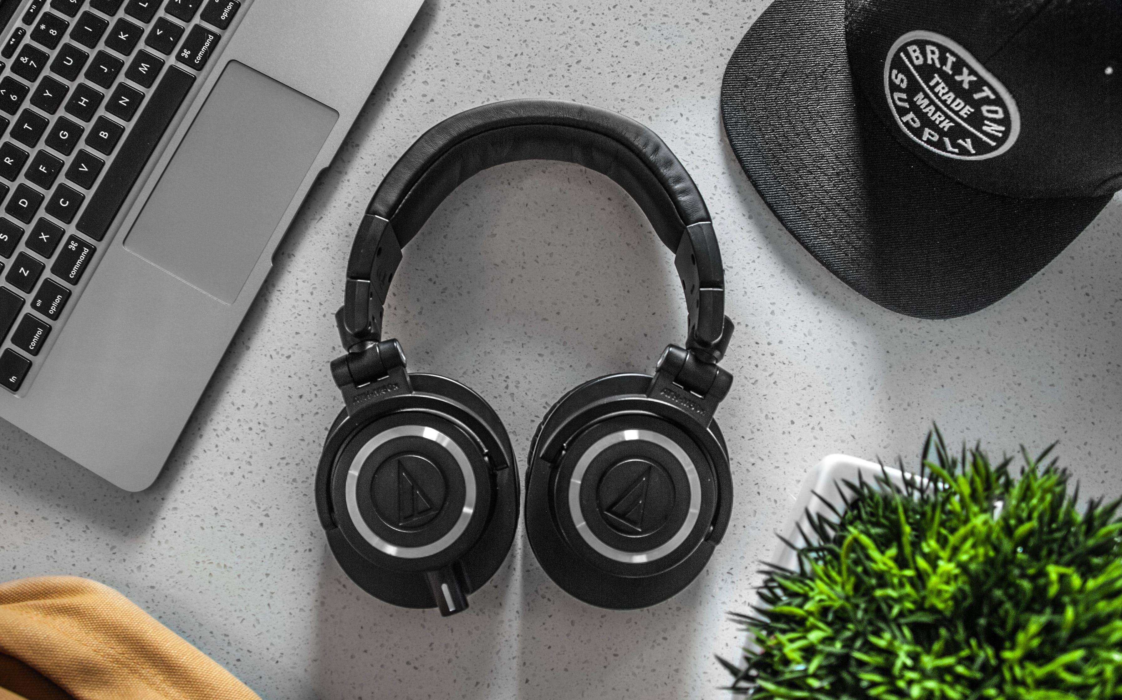 Black Wireless Headphones On White Table
