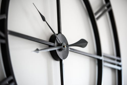 Modern clock on white wall
