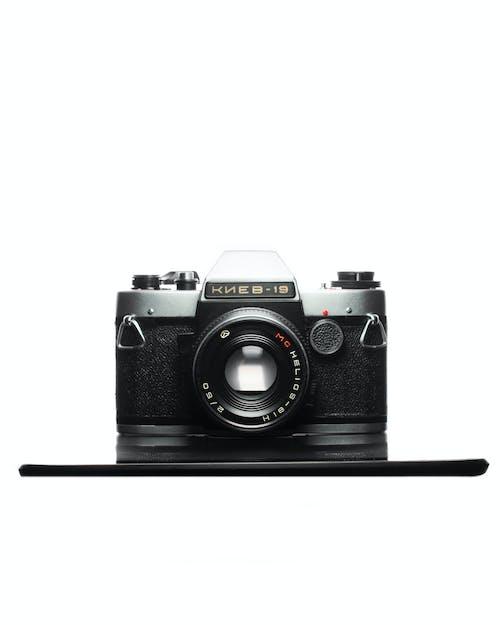 Free stock photo of camera, camera under white light, film camera