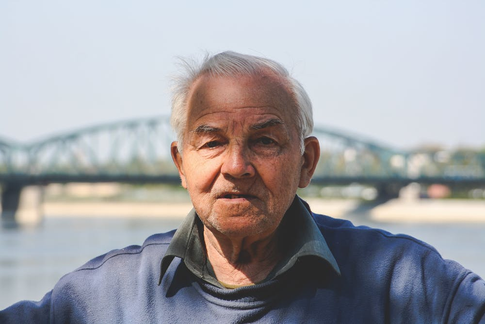 An old man posing to camera. | Photo: Pexels