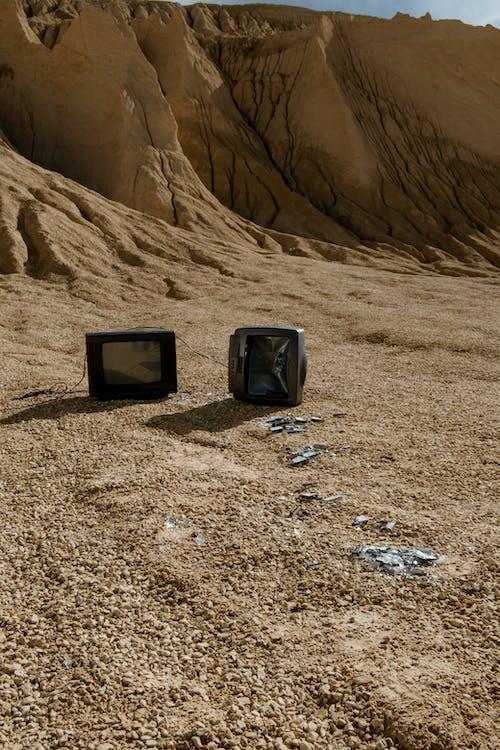 Black Crt Tv on Brown Sand