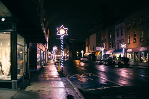 Streetlamps with Stars of David on wet street