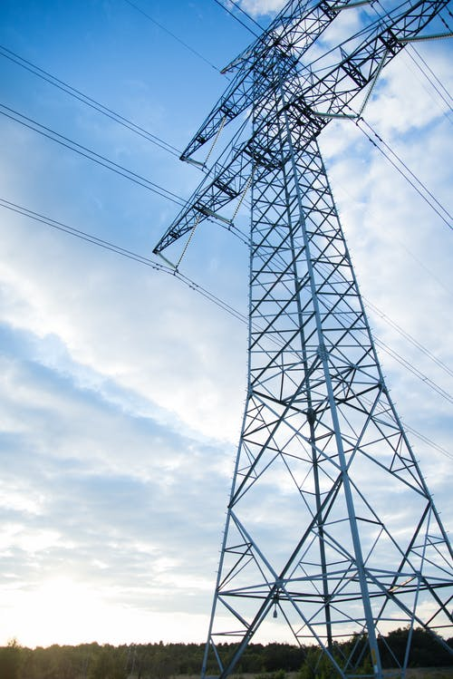 Gray Transmission Line Under Blue Sky at Daytime