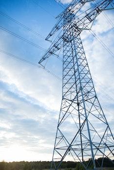 Gray Transmission Line Under Blue Sky at Daytime