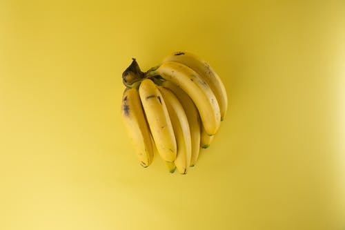 Foto profissional grátis de alimento, amarelo, bananas, close