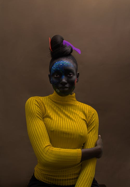 Black woman with bright makeup